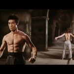 Bruce Lee-Warming up for duel against world karate champion, Chuck Norris