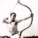 Displaying his use of the bow