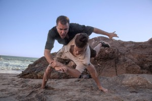 Bury your opponent in the sand with a hip throw!