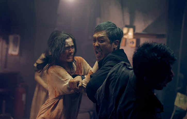 The evil Lee holds Ishmael and Ailin in his grip