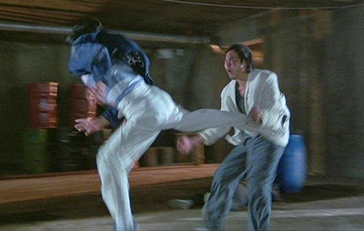 Dick Wei takes a hard kick