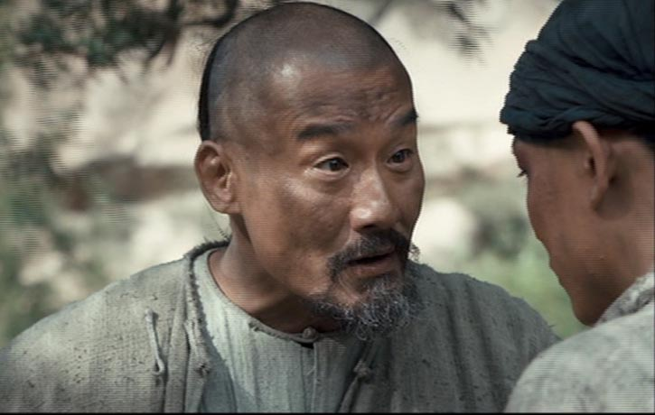 The old and wise Chen Chang Xing passes on some words of wisdom to the young and eager Yang Lu Chan