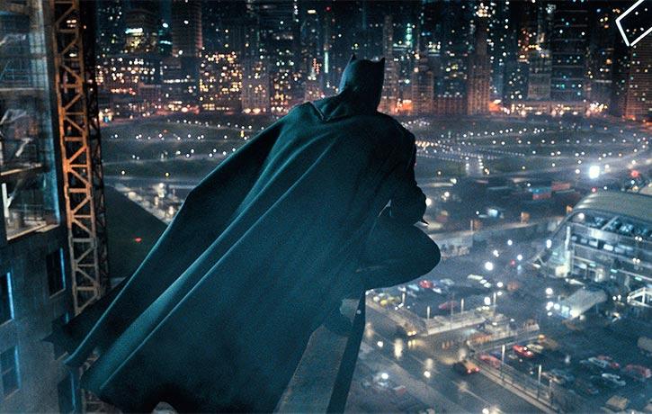 Batman broods over the city skyline