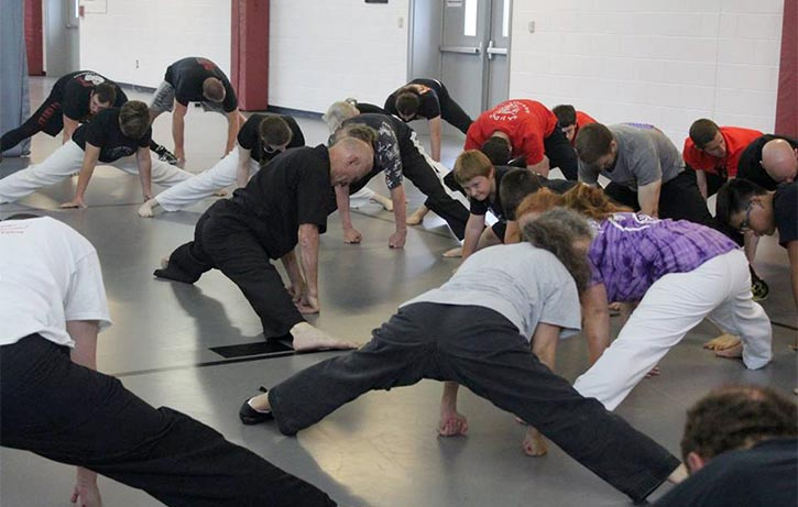 Bill shows his students how to ease into a split