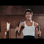 Bruce Lee Bruce Lee armed with double nun chakus..