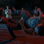 Mark Dacascos Mark does a pirouettic kick on the imposing gangleader Only The Strong