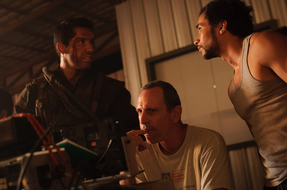Isaac in the midst of it with Scott Adkins and Tim Man