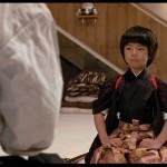 Kid ninja training in dojo