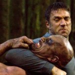 Gary challenges wrestler Steve Austin with a head lock
