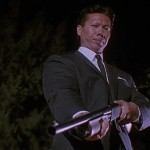 Bolo taking aim in Double Impact