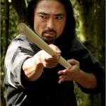 Akira Koieyama wielding a stick with authority