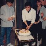 Clean cut Jackie Chan prepares a birthday cake for Kenya