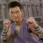 Billy Chow adopts his familiar fighting stance