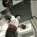 Ken Lo spots Jackie whilst weight training