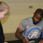 Michael Jai White signing for a fan