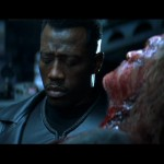 Blade tends to his wounded ally Whistler