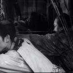 Gorobei takes aim as Katsushiro lies poised at the ready