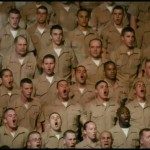 Tommys fellow U.S. Marines salute him