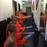 The young monks stretch out backstage