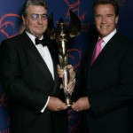 Receiving the Taurus Award from Arnie