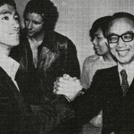 Bruce gives the brothers handshake to Golden Harvest President Raymond Chow at the 1972 premiere of Way of the Dragon