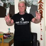 Mark Houghton with Lau Kar Leung pics in background