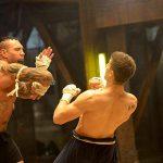Kurt dodges Tong Pos lethal elbow strike 1