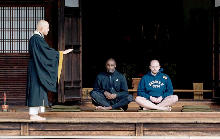 Idris Elba and trainer Kieran Keddle meditate at Kennin ji Temple in Kyoto Japan 2
