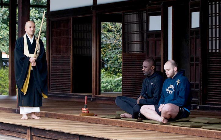 Idris Elba and trainer Kieran Keddle meditate at Kennin ji Temple in Kyoto Japan
