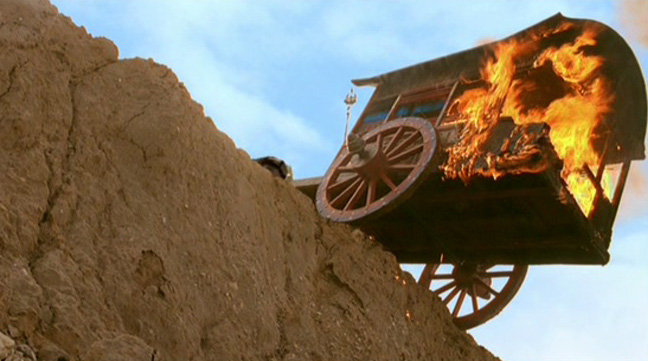 They really did hang the actress in a burning caravan over a cliff