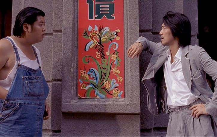 Lam Chi Chung as Bone and Stephen Chow as Sing