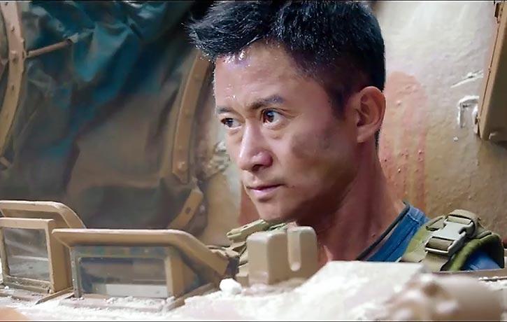 Leng Feng pilots a tank into battle