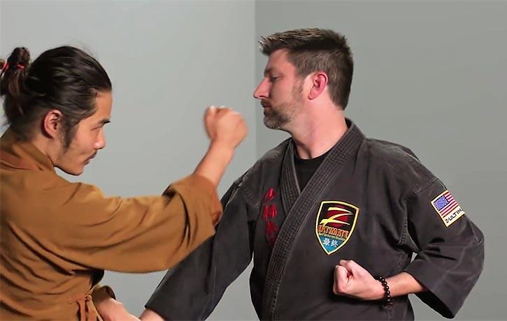 Shifu Wang demonstrates a counter attack to an incoming strike
