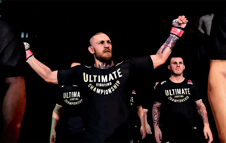 Conor McGregor enters the cage as champ