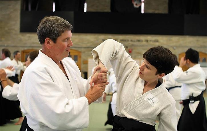 This sensei shows a student how to perform Sankyo