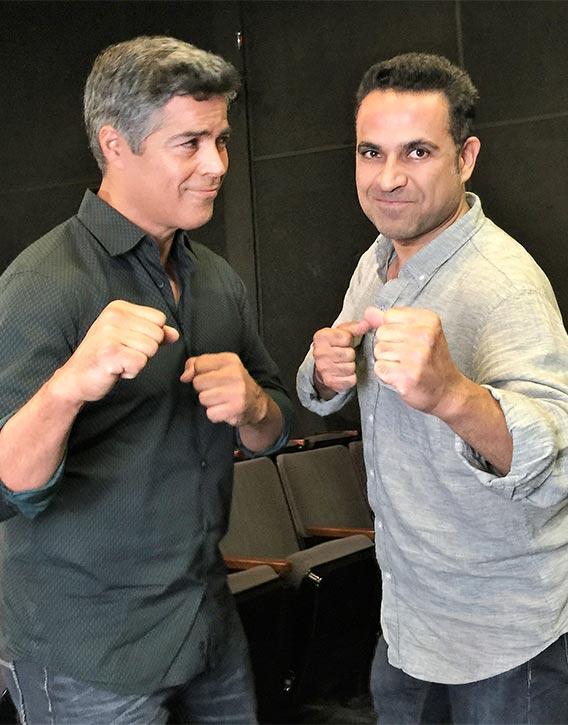 Esai Morales Left shares a light moment with Kevin Derek
