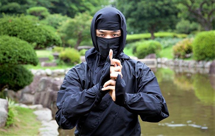 Ninja in Kuji kiri hand power symbol pose