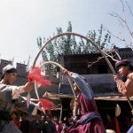 Donnie Yen faces two spear twirling bandits