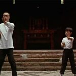 Bruce trains a a child with Wing Chun Grandmaster Ip Man