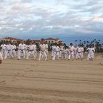 Demura readies his students for training on the beach