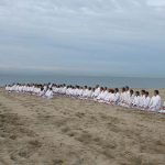 Demuras students meditate on the beach before training