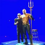 Jon stands tall with Jason Momoa on the set of Aquaman