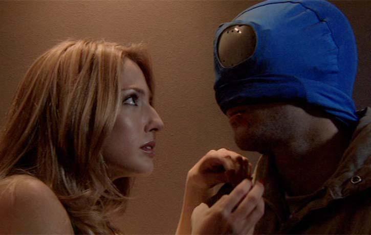 Carol about to unmask Mirageman..