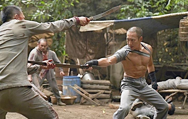 Bruce in a blazing sword fight in Revenger