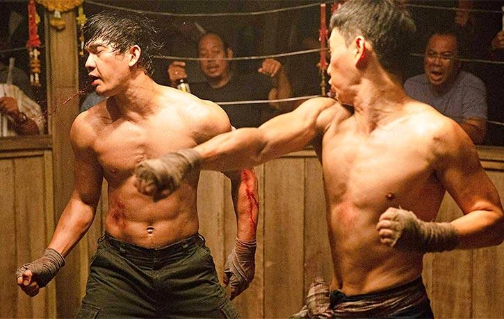 Long Fei lands a punishing strike on Jaka