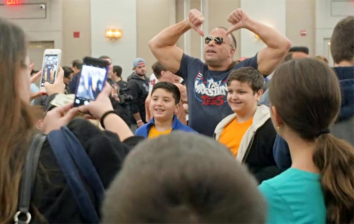 RVD shares a legacy shot with young fans