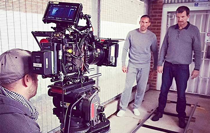 Scott preps for the next shot in Avengement with Jesse Johnson