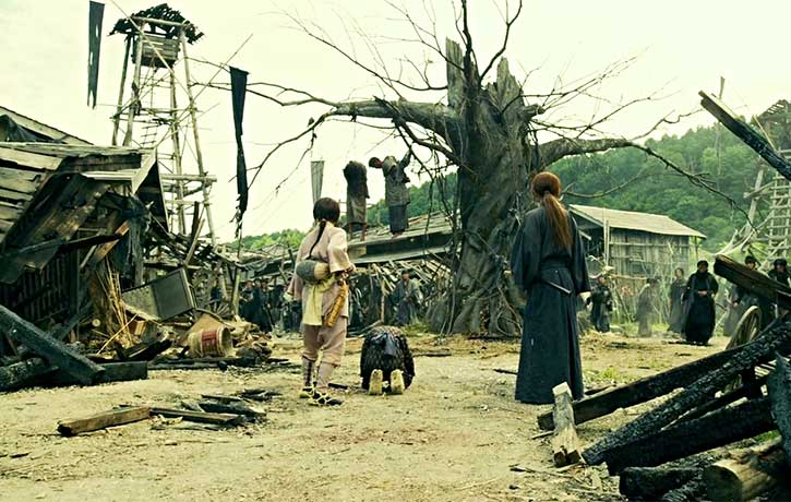 A town is left destroyed by Shishios men