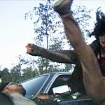 Kim fells her opponent with an axe kick
