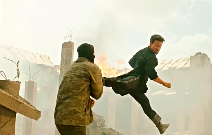 Khalid lands a powerful jump spinning back kick